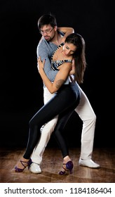 Salsa and bachata dancers in dance poses on white and black backgrounds.