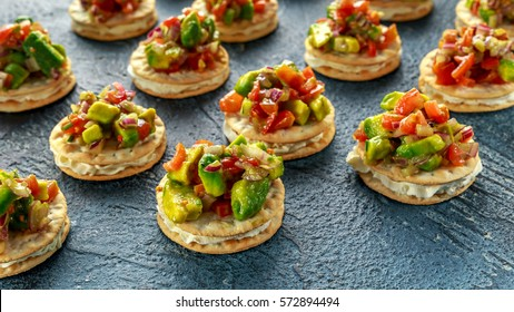 Salsa canape cracker appetizers with soft cheese