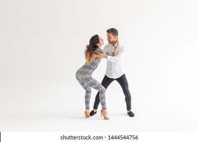 Salsa, kizomba and bachata dancers on white background with copy space. Social dance concept