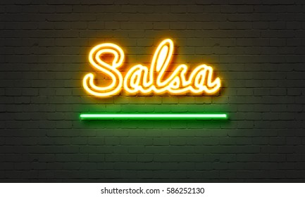 Salsa neon sign on brick wall background
