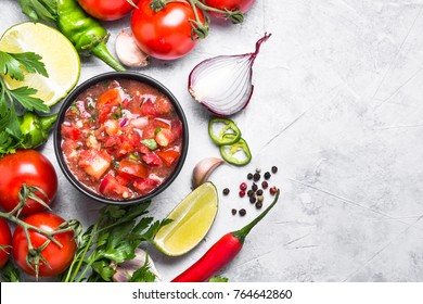 Salsa sauce and ingredients on stone table. Traditional Latin American mexican food. Top view with copy space.