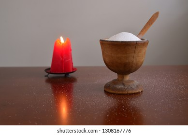 Salt in a bowl with burning candle.