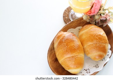 salt butter roll and orange juice