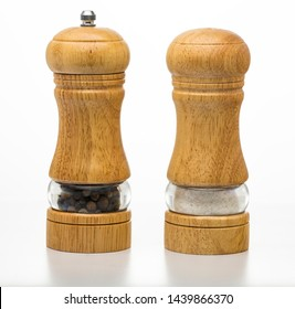 Salt container and pepper mill isolated on white. Sets for spices. Dishes.