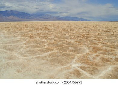 Salt crust in Badwater Basin salt pan, lowest point in North America, Panamint Range left, Black Mountains, Death Valley, Mojave Desert, California, USA, North America