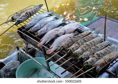 Salt Crusted Grilled Fish over charcoal,Taling Chan  floating Market,Bangkok, Thailand