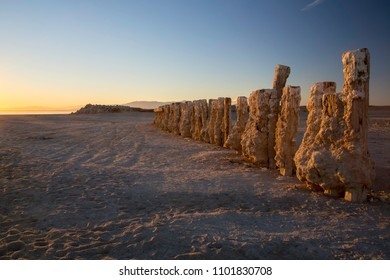 Salt crusted pilings at Bombay Beach on the Salton Sea in Southern California USA.