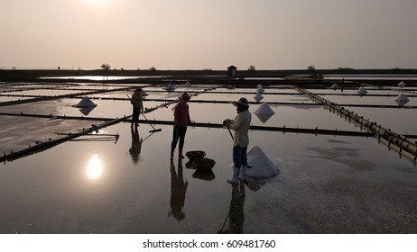 Salt evaporation ponds in silhouette view. It is also called salt field, salterns, salt works or salt pans, are shallow artificial ponds designed to extract salts from sea water or other brines.