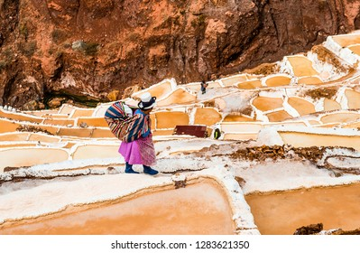 salt extraction in Peru. Workers at Salinas de Maras