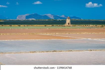 "Salt flats at the natural reserve of the ""Saline dello Stagnone"" near Marsala and Trapani, Sicily."