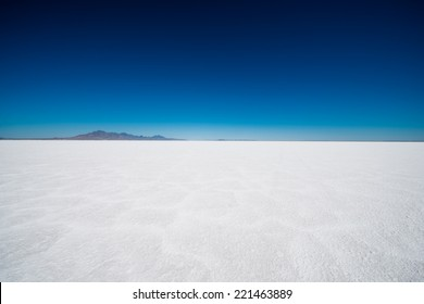 Salt Flats in Utah. Salt Flats Landscape. Dark Blue Sky and Snow White Salt Soil. Boneville near Salt Lake City, Utah, United States. Bonneville Salt Flats