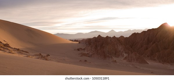 Salt formations and sand dunes at Valle de la Muerte (spanish for Death Valley) also know as Cordillera de la Sal (spanish for Salt Mountain Range) with the Andes Mountain Range in the background