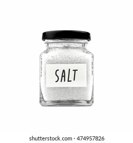 Salt in a glass jar with black lid and sticky note paper isolated on white background, front view.