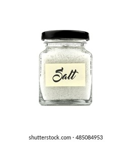 Salt in a glass jar with black lid and yellow sticky note paper isolated on white background, front view.