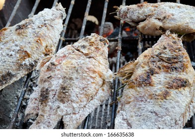 Salt grilled fish on the barbecue stove
