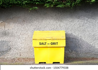 Salt grit yellow container for winter road safety on council road uk
