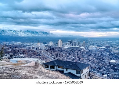 Salt Lake City aerial landscape with snowy mountain and overcast sky views