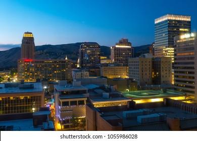 SALT LAKE CITY, USA - JULY 24, 2017: Cityscape of the urban skyline of Salt Lake City after sunset.