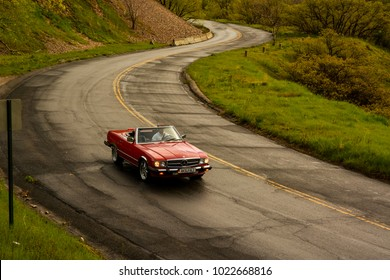 Salt Lake City, UT, USA - April 21 2017: Red 1988 Mercedes Benz 560 SL Convertible