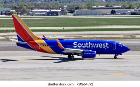 SALT LAKE CITY, UTAH – April 16, 2016: A Boeing 737-700 of Southwest Airlines taxies to the runway for departure at Salt Lake City International Airport.