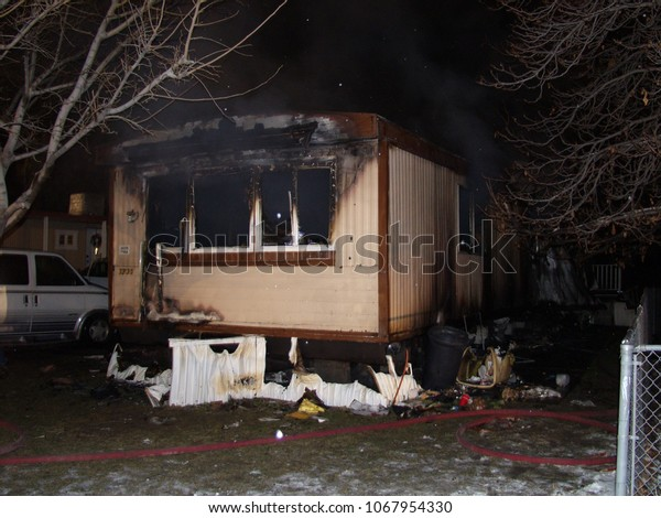 Salt Lake City, Utah, December 2009.  The aftermath of a fire that destroyed a trailer home at night.
