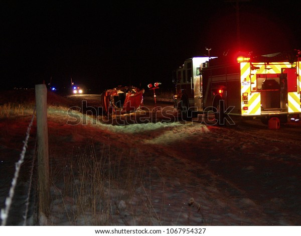 Salt Lake City, Utah, January 2010.  Rollover car accident from driving on icy road on rural country road at night.