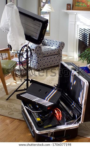 Salt Lake City, Utah, March 2020.  A Kino Flo Diva flourescent video light kit sits in a sunlit living room on a video production set.