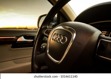 Salt Lake City, Utah / USA - 9 March 2017: Steering wheel of an Audi Q7 luxury SUV looking through the window at sunset.