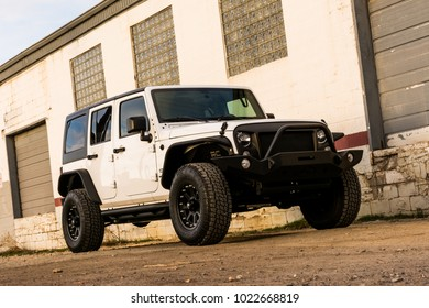 Salt Lake City, Utah, USA  -March 20, 2017: White Jeep Wrangler in urban jungle environment