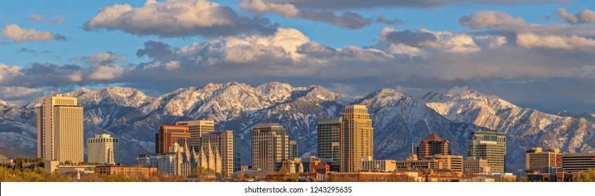 Salt Lake City, Utah, USA - March 5, 2018: Downtown Salt Lake City skyline on an early spring evening with snow capped Wasatch Mountains in the distance.