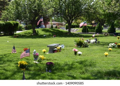 Salt Lake City, Utah / U.S.A. - May 27th 2019: Beautiful sunny memorial day weekend at Elysian Gardens in Utah visiting our fallen but not forgotten family members to pay respects