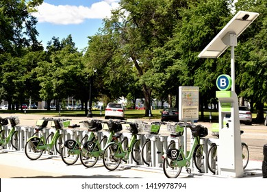 Salt Lake City, Utah / U.S.A. - June 8th 2019: Bike sharing station for Green bike non-profit bike sharing at Library Square downtown is best way to get around with reasonable pricing per half hour