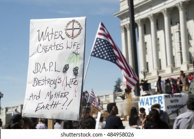 Salt Lake City, Utah, USA - September 28, 2016. Protesters gather in front of the Utah State Capitol in solidarity with Native Americans blocking construction of the Dakota Access Pipeline.