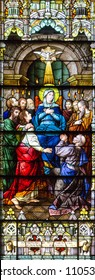 Salt Lake City,Utah,US. 31/08/2017. Stained glass in The Cathedral of the Madeleine depicting the Mother of God in the midst of apostles on Pentecost, and the Holy Spirit descending upon them.