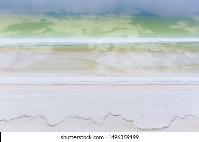 salt lake closeup,blue sky reflection in brine with salt pan crystals, qinghai province, China