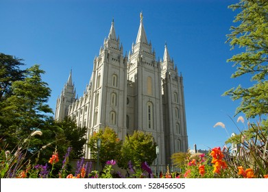 The Salt Lake Temple (Mormon Temple) is located in Salt Lake City Utah, America. Nice view in sunlight with beautiful colors and flowers.