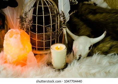 Salt Lamp sacred space with sage candle and bird cage