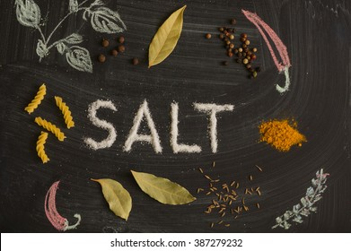 SALT letters, spices and herbs on a blackboard