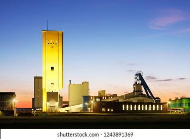 Salt mine with night blue sky.