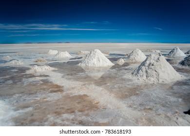 Salt mining demonstration scenery during dessert crossing with a 4x4 car in Uyuni Salt Flats in Bolivia.