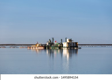 salt mining ship and reflection in qarhan salt lake, golmud city, qinghai province, China