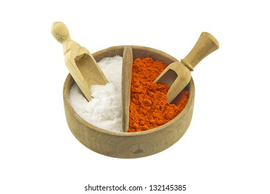 Salt and paprika in a wooden salt box isolated on white