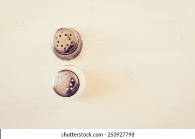 Salt and pepper on a white table top view