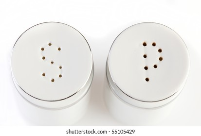 Salt and pepper pots on white