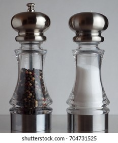A salt and pepper shaker side by side.