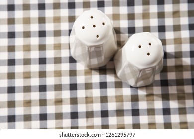 salt and pepper shakers on the checker table cloth