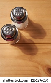 salt and pepper shakers on the wooden background