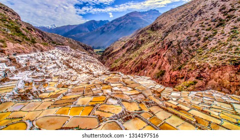 Salt ponds near Maras, high in the Peruvian Andes. Village families each own one or more of these ponds. The ponds are fed from a small stream and the water is evaporated off by the strong sun.