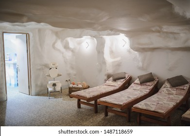 salt room in spa salon: relaxing beds in white interior