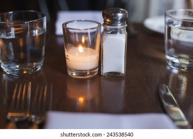 Salt and tea candle on a restaurant table